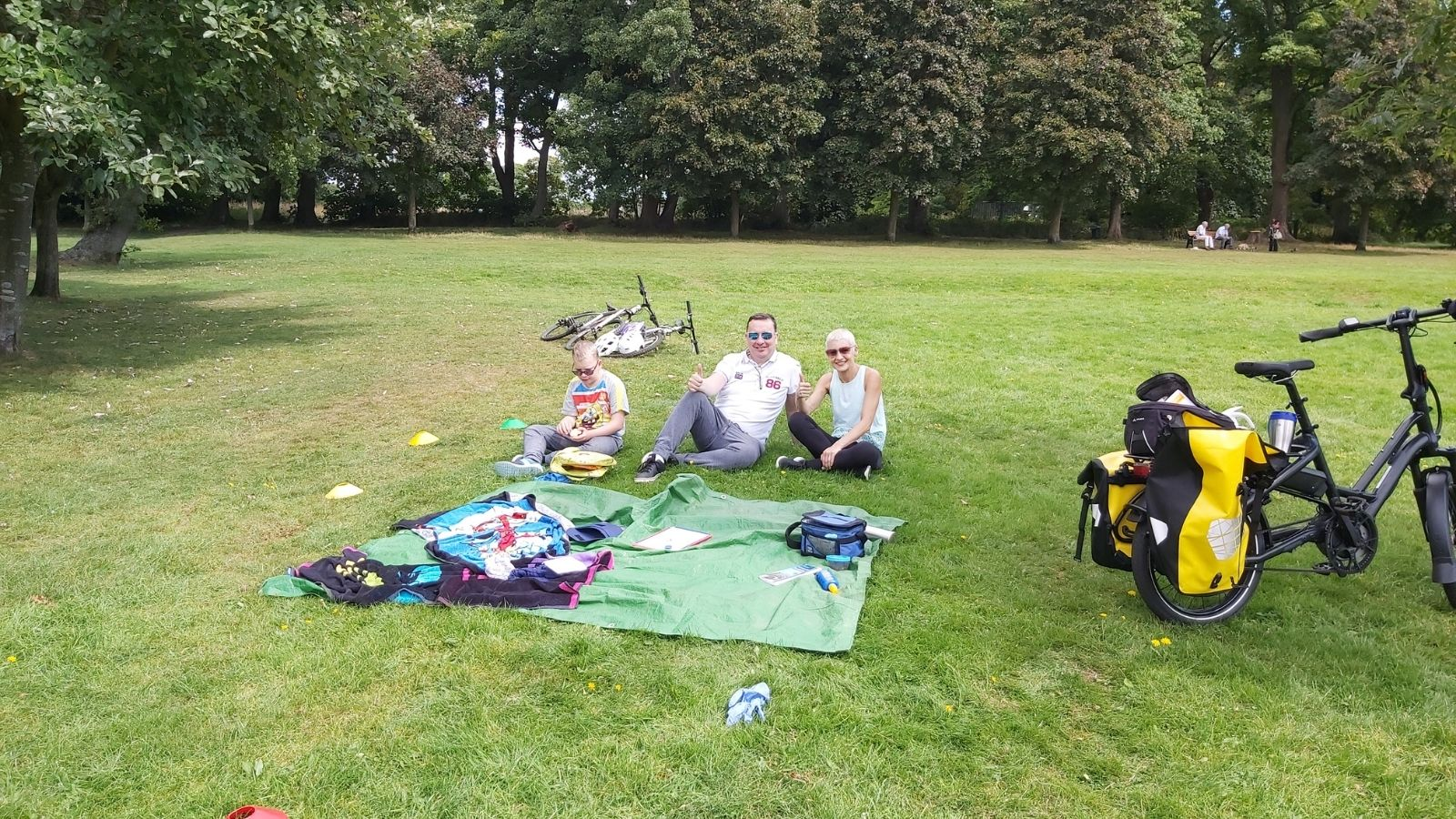 Josh enjoying a picnic in the park after a cycle ride