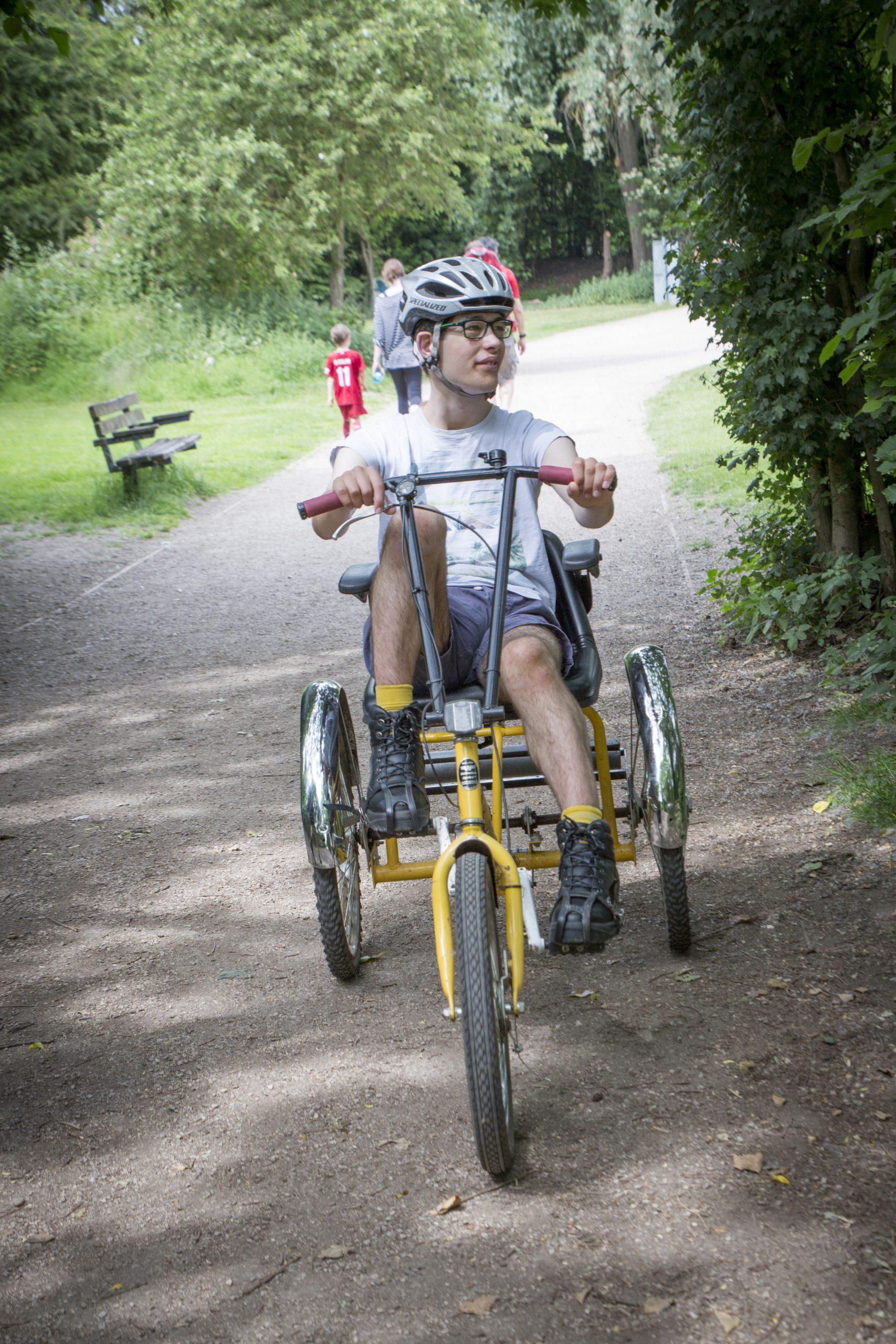 A boy cycling on a trike