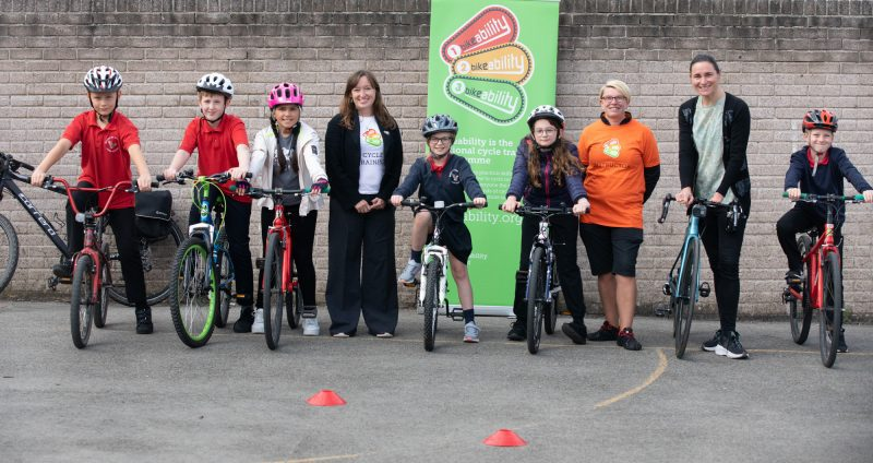 Children taking part in Bikeability session with Dame Sarah Storey and Emily Cherry