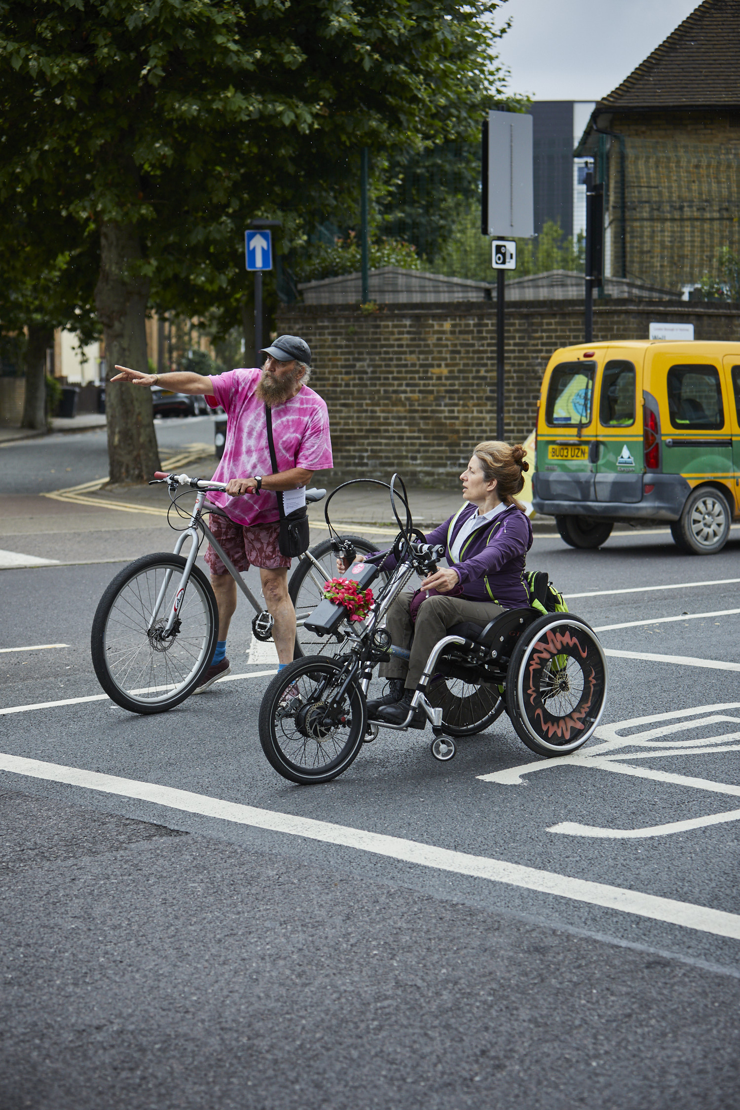 Instructor teaching a cyclist on trike to become an instructor