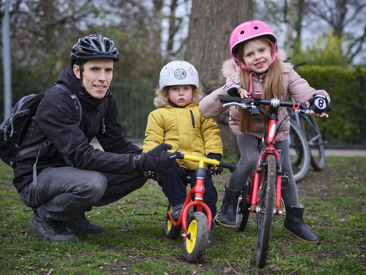 Family of three posing with cycles
